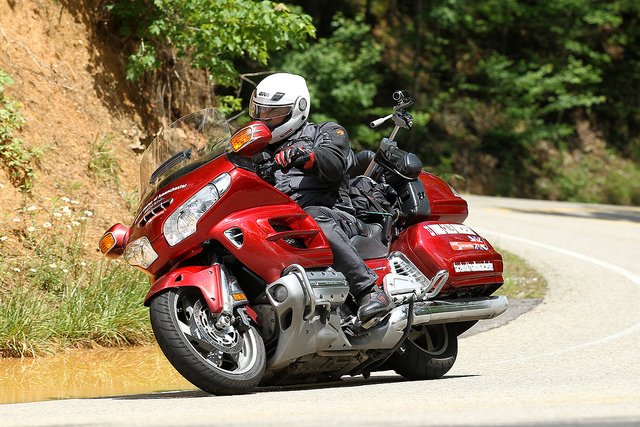 Red Honda Goldwing riding round corner