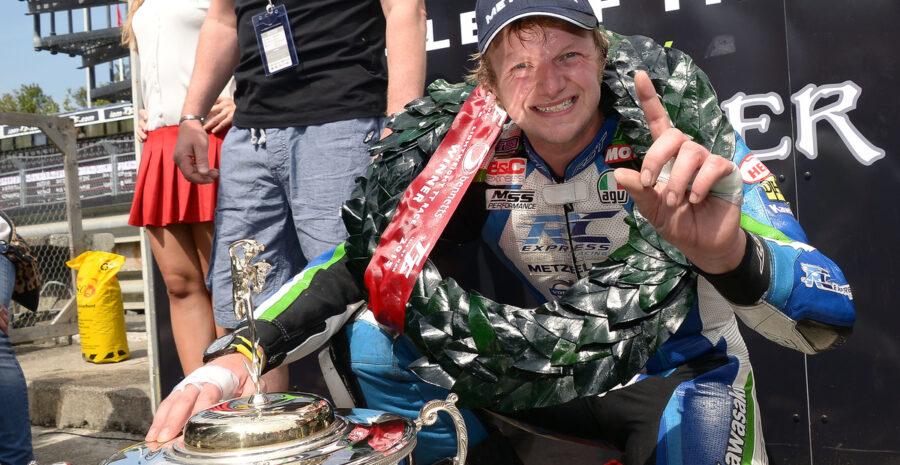 #6 Ivan Lintin celebrating his Lightweight TT win 2015