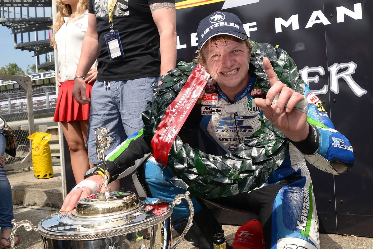 #6 Ivan Lintin celebrating his Lightweight TT win 2015
