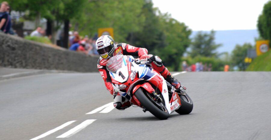John McGuinness on the Honda Racing Fireblade at Signpost during the the Pokerstars Senior TT race at the 2015 Monster Energy Isle of Man TT