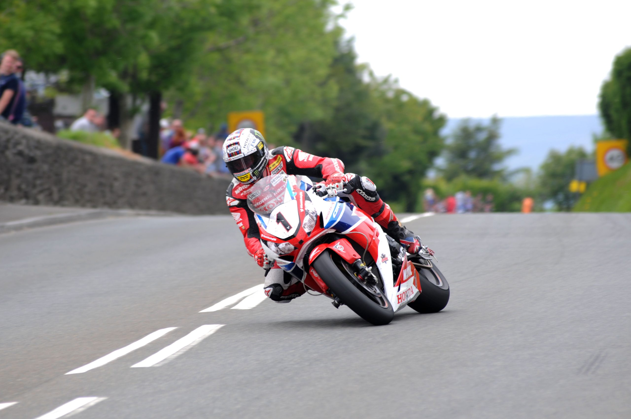 John McGuinness on the Honda Racing Fireblade at Signpost during the the Pokerstars Senior TT race at the 2015 Monster Energy Isle of Man TT