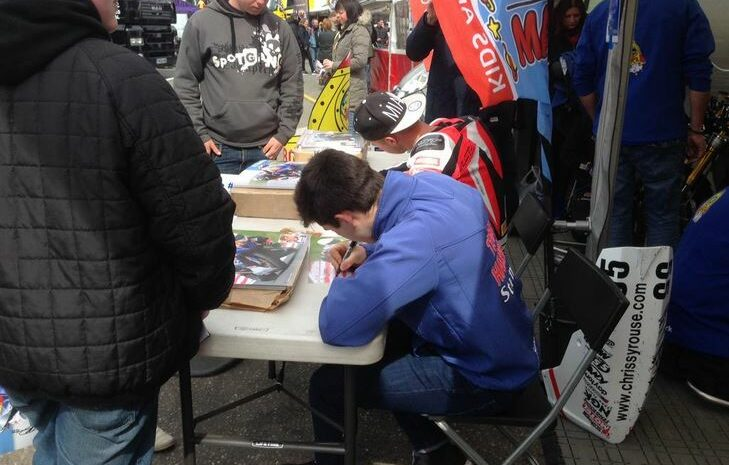 signing autographs at Brands