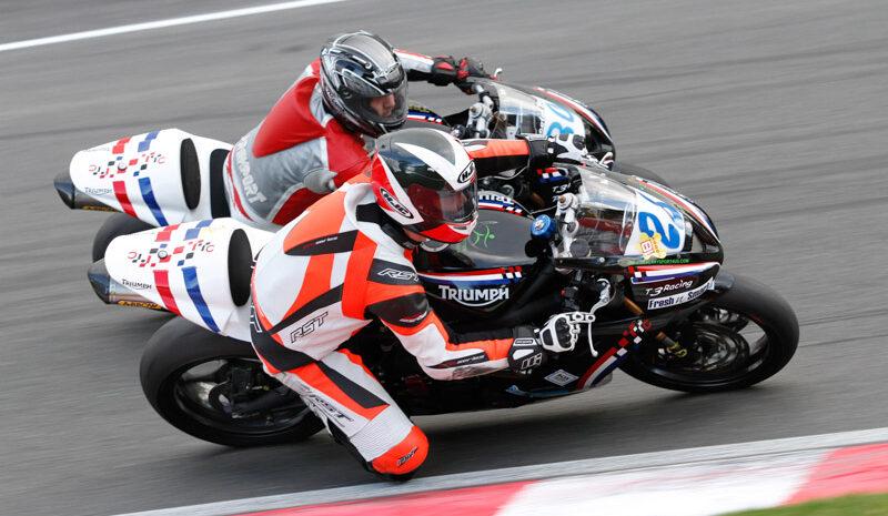 two-bikers-racing