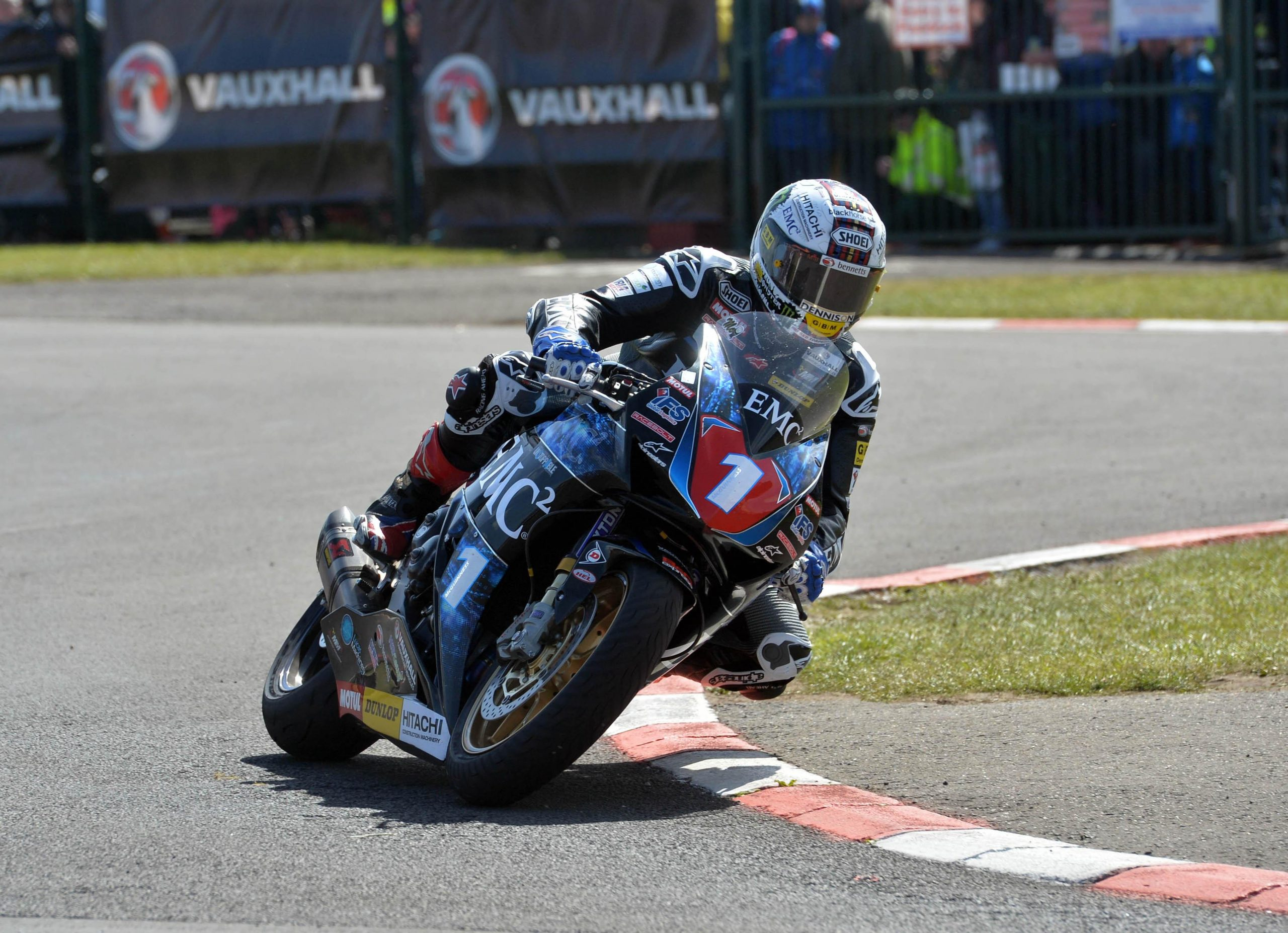 John in action at the NW200 on the EMC2 Superstock Honda by Pacemaker Press International