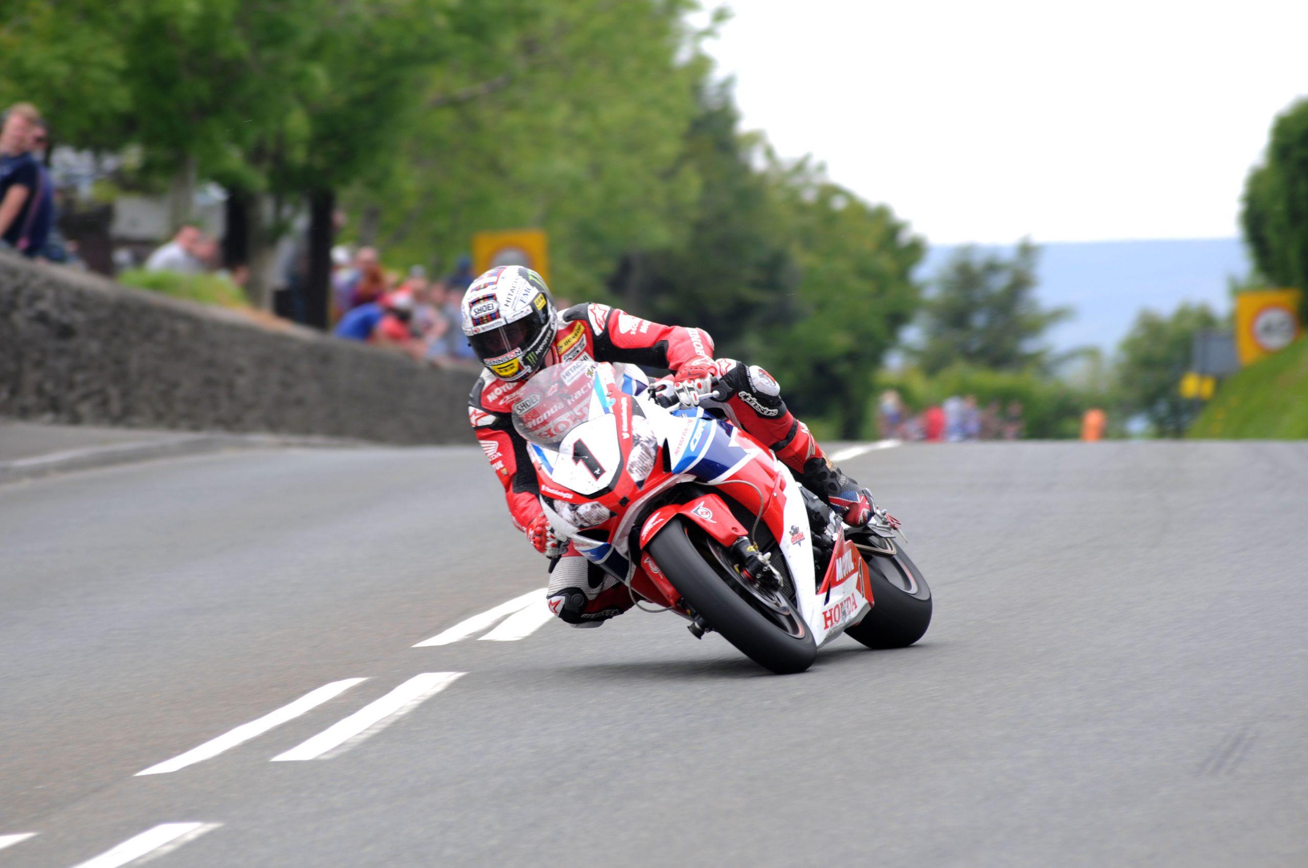 John McGuinness winning the Senior TT image by Pacemaker Press International