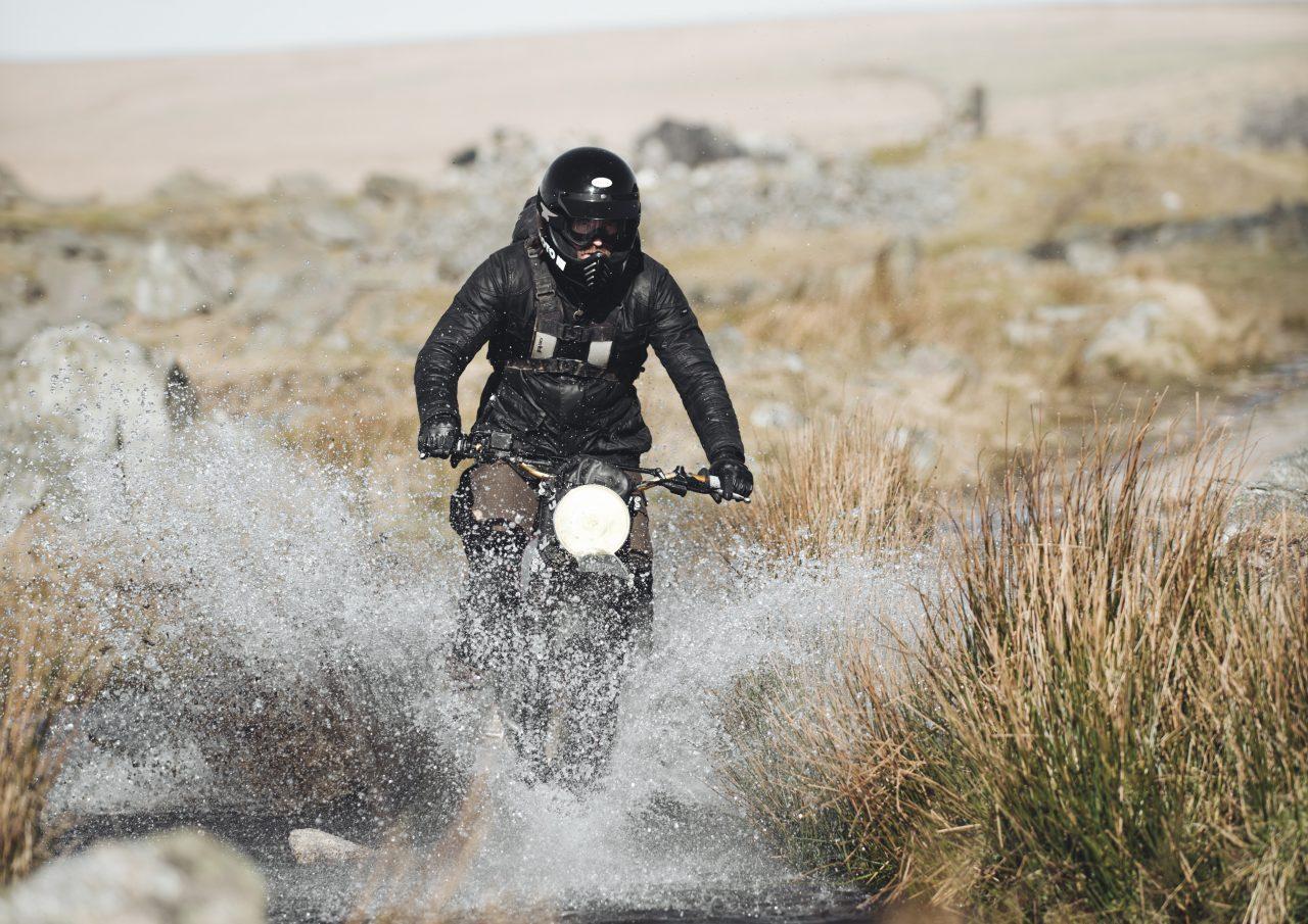 Biker riding through puddle