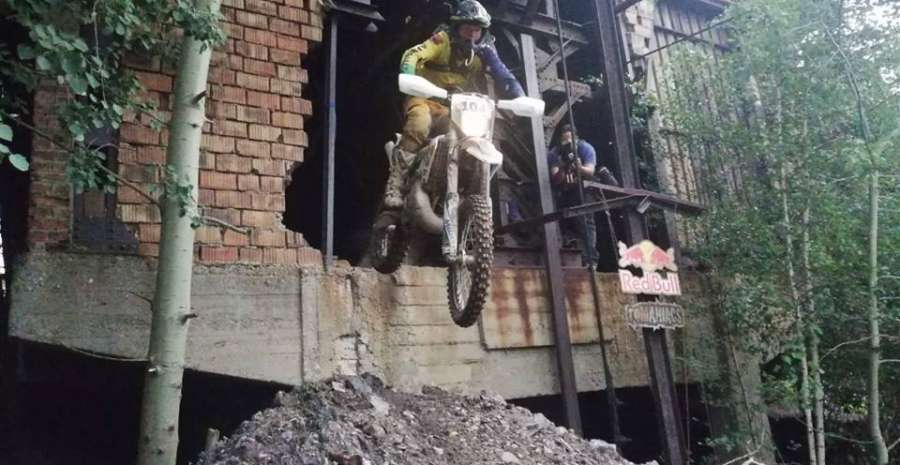 Bike leaving building at Red Bull Romaniacs credit official Red Bull Romaniacs official facebook page